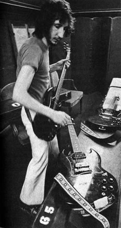 Ca. 1971, backstage with three Gibson SG Specials, one capoed at the third fret.