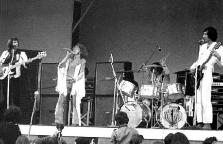 August 1969, the 2nd Annual Isle of Wight festival, which featured The Who's 2,500-watt WEM PA system. WEM speaker columns and cabinets as foldback behind John and Keith.